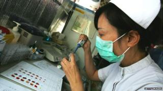 A Chinese medical worker prepares a blood donation at a hospital in Beijing - 7 September 2007