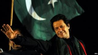 Imran Khan waves to supporters at a mass anti-government protest in Islamabad - 20 August 2014
