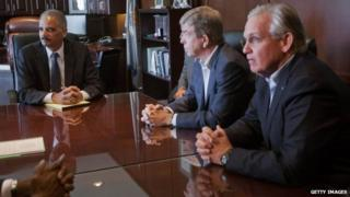 "U.S. Attorney General Eric Holder (L) meets with US Senator Roy Blunt, (R-MO) (C) and Missouri Governor Jay Nixon at the US Attorney""s office 20 August, 2014 in St Louis, Missouri"