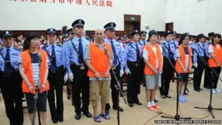 Defendants stands trial in Yantai, Shandong, 21 Aug 2014