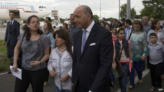Newly arrived Iraqi Christians with French Foreign Minister Laurent Fabius