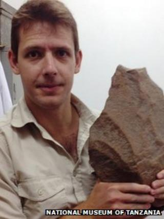 James Cole with a Stone Age handaxe