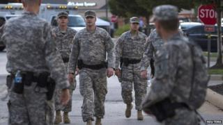 National Guard troops walk through a Ferguson street