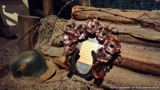 Ironwork wreath and a WW1 helmet