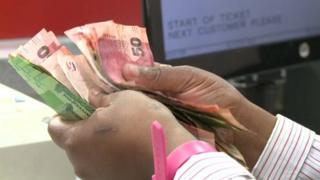 Counting cash in South Africa supermarket