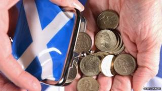 Scottish purse tipping out money