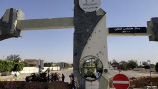 The damaged entrance to Tripoli International Airport, captured by by fighters from the Libyan Dawn coalition from Zintan militias, 24 August.
