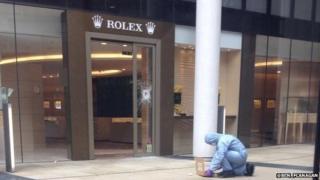 Crime scene investigators outside the Rolex store, Knightsbridge