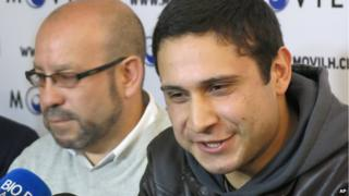 Mauricio Ruiz, 24, sailor of the Chilean Navy, right, comes out publicly as gay in Santiago, Chile, 27 August, 2014.