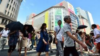 June 14, 2014 people strolling in Tokyo's Ginza shopping district.