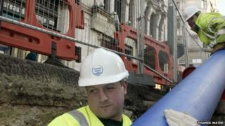 Thames Water worker fixing sewer
