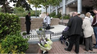 A private memorial service is held to open the garden