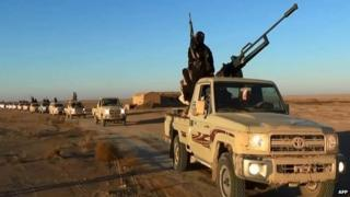 An image grab taken from a propaganda video uploaded by Islamic State allegedly showing militants driving at an undisclosed location in Iraq's Nineveh province
