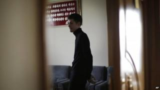Mathew Miller, an American detained in North Korea, waits in a room.