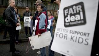 British Columbia Teacher Federation (BCTF) President Jim Iker, left, joined supporters outside the Britannia Secondary and Elementary Schools in Vancouver, British Columbia 2 September 2014