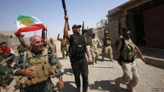 Kurdish peshmerga forces celebrate as they take control of Sulaiman Pek from the Islamist State militants