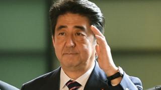 Japanese Prime Minister Shinzo Abe (C) arrives at his official residence in Tokyo on 3 September 2014