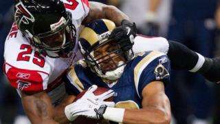 An Atlanta Falcons defender tackles a St Louis Rams player in a game in November 2010.