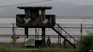 South Korean soldiers patrol at the border with North Korea near the Demilitarized Zone (DMZ) on 14 August 2014