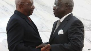 Mozambique President Arnando Guebuza, left, and former Renamo rebel leader Afonso Dhlakama, right, shake hands after signing a peace accord Friday, Sept. 5, 2014.