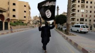 An IS member in Raqqa, Syria in June 2014