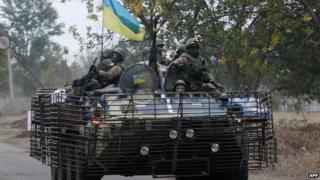 Ukrainian soldiers patrol in a APC in the eastern Ukrainian city of Kramatorsk, Donetsk region on 11 September 2014.