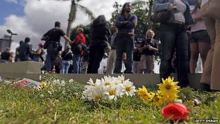 People lay flowers to demonstrate against violence and the high murder rate in Venezuela on 12 January, 2014.