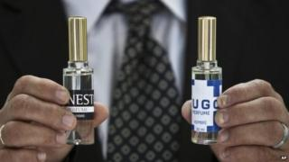 Bottles of the two scents, Hugo and Ernesto, being launched