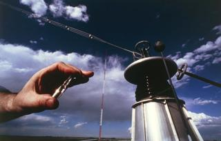 Caesium in a vial being held in front of a time station