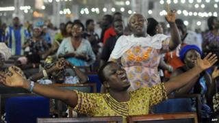 Worshippers pray into the New Year during the crossover watch night church service at the Redemption Camp on Lagos Ibadan highway on 1 January 2014