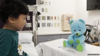Child in hospital with Huggable