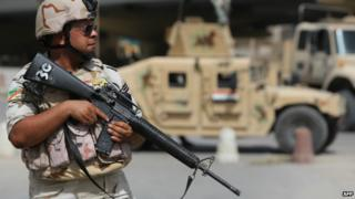 An Iraqi soldier stands guard on a street corner in Iraq's capital Baghdad - 25 September 2014
