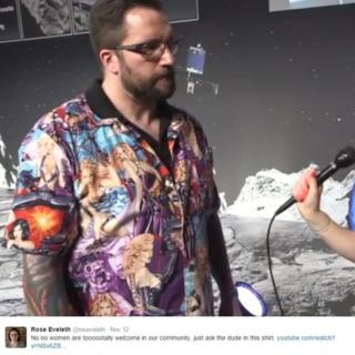 Matt Taylor wearing a shirt covered in half-dressed women