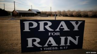 Pray for rain sign