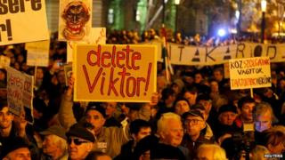 People protest in front of the Hungarian parliament in Budapest, Hungary on 17 November 2014