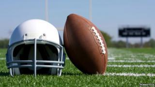 An American football and helmet