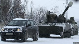 Russian armour on a road in rebel-held eastern Ukraine