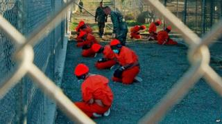 Detainees are observed by US military police at Camp X-Ray in Guantanamo Bay, Cuba - 11 January 2002