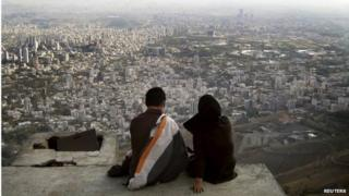 Iranian couple overlooking Tehran (file photo)