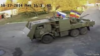 CCTV image of men on an armoured truck