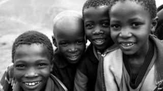 A handout picture taken by Prince Harry shows Lesothan children posing for a photograph at a herd boy school supported in Mokhotlong, Lesotho (December 2014)
