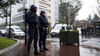 Police officers secure the area near the headquarters of French Central Directorate of Interior Intelligence on 8 January