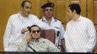 Gamal Mubarak, Hosni Mubarak and Alaa Mubarak in court (14 September 2013)