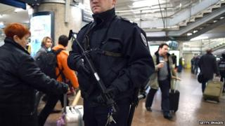 A French police officer patrols at the SNCF railway station La Part-Dieu in Lyon on 16 January 2015