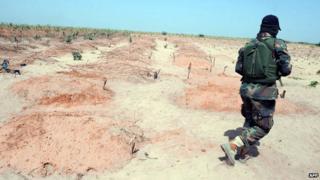 A soldier walks alone in Baga, Nigeria