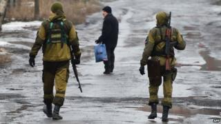 Pro-Russian rebels on patrol in Makiivka, a suburb of Donetsk (1 Feb)