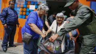 Old lady leaves Dia a Dia supermarket, Caracas, Jan 3 2015