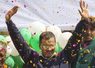Leader of the Aam Aadmi Party, or Common Man's Party, Arvind Kejriwal waves to the crowd as his party looks set for a landslide party in New Delhi, India, Tuesday, Feb. 10, 2015