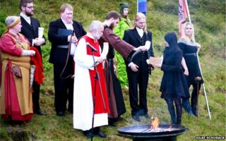High priest of the Asatru Association, Hilmar Orn Hilmarsson, leads a ceremony at the Pingvellir National Park near Reykjavik in June 2012.