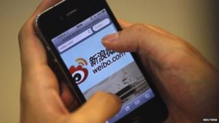 File image of a man using the Sina Weibo microblogging site in Shanghai on 29 May 2012